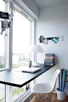 Floating desk in front of window very nice!