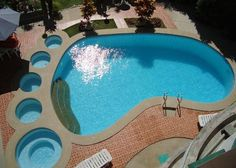 Swimming pool:  Footprint shaped swimming pool - Big pool for me - descending sizes for R and the kids!!