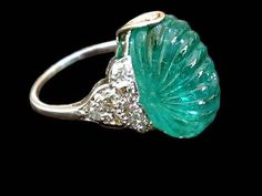 """French Art Deco platinum ring comprising an important 20 carat carved bead emerald set in the Indian Moghul style.""    Tags: art deco. jewellery. jewelry."