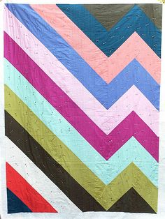Hey! Big zig quilt. Would love in two colors (cream and turquoises) Need to bust out that sewing machine.