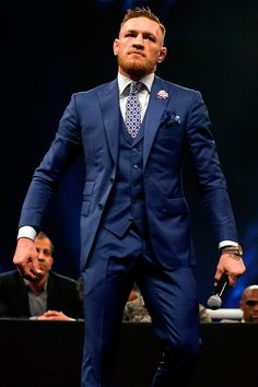The MMA fighter's wardrobe is loud and bold and badass as Conor McGregor. From off-duty dad rigs to tailored kits, here are his best fits—all in one place. Conor Mcgregor Haircut, Conor Mcgregor Suit, Mcgregor Suits, Notorious Conor Mcgregor, Connor Mcgregor, Conor Mcgregor Costume, Mens Fashion Blog, Suit Fashion, Boxe Mma