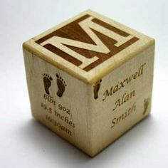 Wooden baby block with all the facts- This would be an adorable display piece in a nursery.