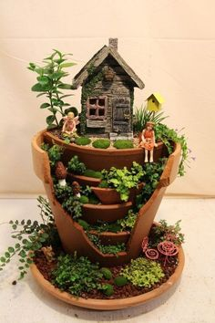 Broken Pot Fairy Garden - this looks much nicer than my broken pot fairy garden!
