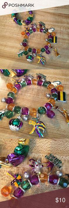 Mardi Gras Caen bracelet Mardi Gras charm bracelet. I'm also including another Mardi Gras stretch heart bracelet. Jewelry Bracelets