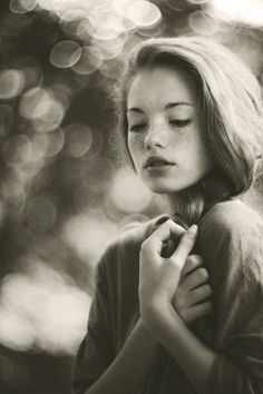 Portrait Photography by Marta Syrko. Grayish tint. Bokeh. Soft expression.
