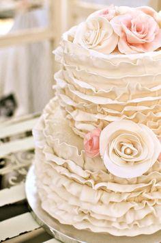 Ruffled #wedding cake with flowers