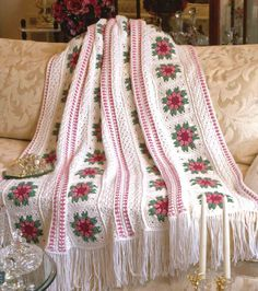 Rows of beautiful flowers captured in delicate, lace-edged panels create the gracious, old-time charm and elegance of this easy strip design that's as pretty as an English country garden. Skill Level Intermediate Size 52 x 61 inches, excluding Fringe Materials Medium (worsted) weight yarn: 50 oz/2,500 yds/1,418g white 11 oz/550 yds/312g pink 7 oz/350 yds/198g green 3 oz/150 yds/85g dark pink Sizes G/6/4mm and H/8/5mm crochet hooks or...