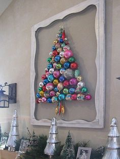 An old window or picture frame is just the thing for displaying an arrangement of cast off Christmas tree ornaments. Have your local glass merchant cut glass to size and then use a hot glue gun to arrangement old ornaments