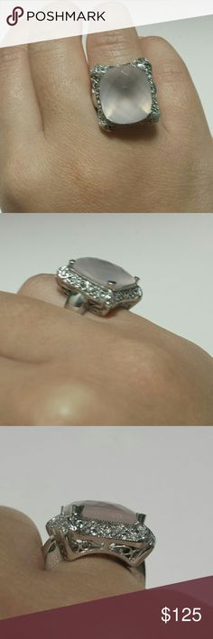 Rose Quartz Statement Ring This ring is sterling silver stamped .925. It features a large rose quartz center stone with diamond accents.  Fits like a size 5.   No trades.   Please submit any offers through the offer option. Jewelry Rings