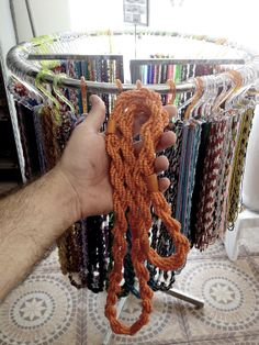 "33 - Guia ou Fio de contas  Literally ""Wire-Beads"", are necklaces usually made ​​of colored beads according to the Orisha, each one has meaning as well as its color. Through Fio de Contas that one can know the degree of a person's initiation of Candomblé, and what nation belongs."