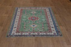 Hand Knotted Kazak Rug from Afghanistan. Length: 247.0cm by Width: 164.0cm. Only £1381 at https://www.olneyrugs.co.uk/shop/rugs-for-sale/afghan-kazak-21533.html    Come and view our majestic display of oriental rugs, carpets, footstools and Kilim cushions at www.olneyrugs.co.uk