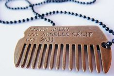 The Beard Buddy Dog Tag Comb Keeps Your Beard in Check trendhunter.com