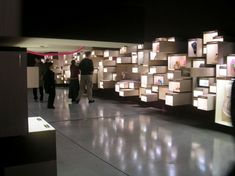 Museum exhibition: multilevel lighted cubes - would be cool for individual products