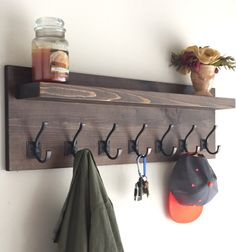 This Rustic Coat Rack measures 36 Long x 11High x 5Deep. Comes with Oil Rubbed Bronze Hooks. Its built using solid pine wood. With a variety of