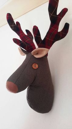 This certainly will be a conversation piece in your home! He is made from a herringbone effect wool/polyester type fabric in dark brown. His wired antlers are made in a lovely rich dark red, brown and cream tartan, making him look very smart!  He measures 20 inches from the tip of his antler to bottom of his neck and has a hook already attached for immediate hanging  If you are interested in different colours please check out my other listings, or if you cant see just what you are after…