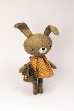 there's something wonderful about this little rabbit doll and her dress and bag