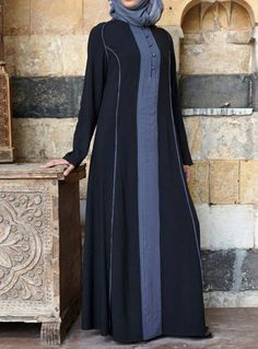 Contrast Pleated Abaya Noir color The fun details are not to be missed in our new Contrast Pleated Abaya! The lovely colors are subtle enough for the office, modest enough for the masjid, and festive enough for a night out. The modest cut and breezy fabric allow for extra comfort, while the buttons and pleats add a bit of flair.