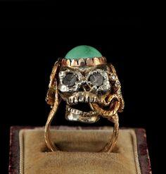 Glamorous him or her memento mori huggie skull and snake diamond ring via Etsy.