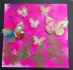 butterfliecrafter: pink and butterflies background is bubble gum pink Dylusions spray ink on a piece of scrap paper on which I cleaned of stamps. The ferns are stencilled with green acrylic paint. Finished of with my favorite subject: butterflies.