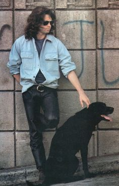 Jim Morrison with his dog, Stone, at the Griffith Observatory, 1968. Photo by Paul Ferrara.