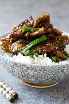 A bowl of mongolian beef over rice.