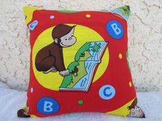 12x12 inch Kid/Children's Nursery Bedroom Pillow Cover - Curious George Monkey Design - ABC, Red, Yellow, Blue. $12.00, via Etsy.