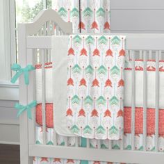 "Coral and Teal Arrow Crib Blanket | Carousel Designs.  Our soft and lightweight crib blanket is just the thing to wrap your baby up, snug as a bug in a rug. At 34"" x 43"", it's the perfect size for the newest addition to the family."