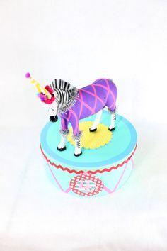Circus Animal Stand Large Aqua by PaintedParade on Etsy, $25.00. Perfect circus/carnival party decoration. Has customizable age, and can customized to a party's colors. Would be good in place of a cake topper, or as centerpiece of table.