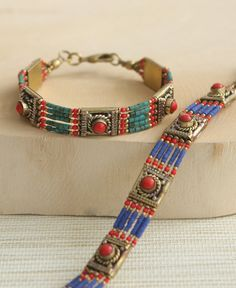 Delicate bracelet made from strands of turquoise color or lapis color beads is set with pieces of fiery red beads. Made in Nepal.