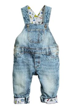 Denim dungarees: Dungarees in soft washed denim with adjustable straps, a chest pocket, fake pockets at the front, one back pocket, press-studs at the sides and crotch and patterned turn-ups at the hems.