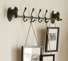 Another way to display photos/artwork in the home - Row of Hooks | Pottery Barn