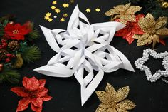 3-Dimensional paper snowflakes look beautiful hanging in a window or on a wall. Fun for kids or adults, they are easy to make. Some like them for Christmas, but you may like them any time! Gather materials. You'll need 6 pieces of paper...