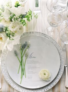 Lavender and ranunculus topped wedding table setting: Photography: Judy Pak - http://judypak.com/