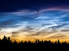 Noctilucent Clouds Mysterious night-shining clouds and trails of smoke left by meteors share an intimate link, a new study says… (read more: National Geo) (photo: Chris Martin) Natural Phenomena, Heaven On Earth, Beautiful Landscapes, Mother Nature, Landscape Photography, Scenic Photography, Beautiful Places, Beautiful Sky, Sunrise