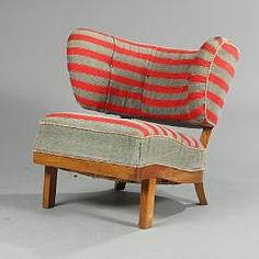 Otto Schulz: Easy chair with elm frame, seat and back with red- and grey-striped fabric. Manufactured by Boet, Sweden. 1940's.