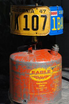 Upcycled rat rod lamp with vintage gas can and 1947 California license plate as part of the shade. Also has a 1989 CA plate and untagged Nevada plate. Very colorful! Would look great in any man cave!