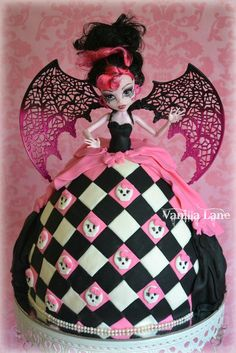 Draculaura doll cake. My second attempt at her……she is much improved on first version as I was running short of time back then. If I make her again – I would like to attempt to make the doll plus the cake. I am very happy with how she turned out :)