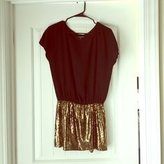 Express Dress Worn once. Black on top with gold sequined skirt. Casual or dressy wear. Express Dresses