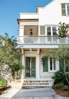 .Love the upstairs balcony and side porch...very Southern.