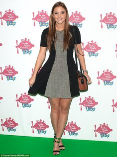Brunette beauty: Jacqueline Jossa had her tanned legs on show in a chic knee-length black ...