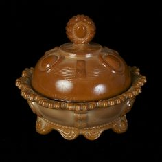 """Object of the day: Chocolate slag glass butter dish in """"Dewey"""" pattern, Indiana Tumbler and Goblet Co., Greentown, IN, 1900-03, KSUM 1983.5.82 ab."""