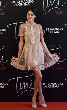 Martina Stoessel Photos - Argentinian singer and actress Martina Stoessel poses during a photocall of the movie Tini - La Nuova Vita Di Violetta (Tini - The New Life of Violetta), on april 29,2016 in Rome. / AFP / TIZIANA FABI - 'Tini - The New Life of Violetta' Photocall in Rome