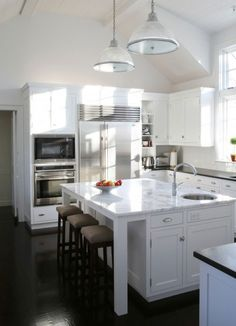 shaker cabinets with dark floors and light fray countertops