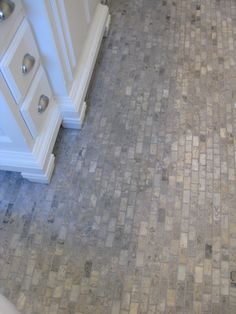 "the cottage bathroom floor is 1""x2' silver Travertine From Stone Dock Outlet in Anaheim, Calif"