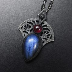 One of a kind blue labradorite and ruby pendant of Goth or Art Deco style, made by a Japanese jewelry artist. (C) KAZNESQ
