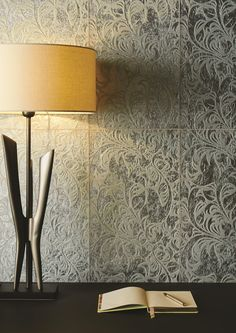 Honfleur Silver glass tiles feature a textured surface, as the pattern is etched with a floral/lace effect to create depth. Cool silver creates a sense of luxury wherever they are used. www.originalstyle.com