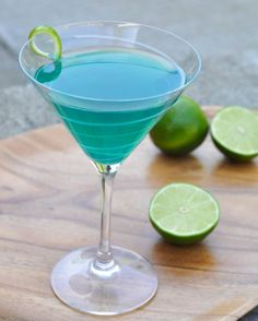 Sweet Tart Martini: Vodka, Amaretto, Blue Curacao, Simple Syrup, Lime Juice, Twist of Lime.