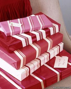 Wrap candy boxes in solid-color red or white paper and wind different colors and widths of ribbon around them. Fill out a simple white gift tag and thread the ribbon through it.