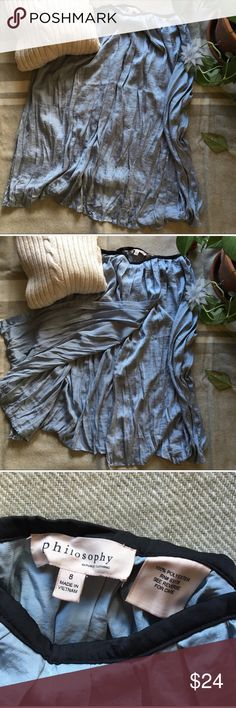 Philosophy silver blue pleated full skirt This blue is such a cool yet warm hue of blues and silvers. It is a faux wrap, has a black waist lining with zipper.   Gives it movement along with pleats. Philosophy Skirts A-Line or Full