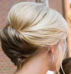 A basic, romantic updo will never go out of style. Rather than forcing hair into complex designs and deploying hundreds of bobby pins, many modern brides are choosing updos that are both easy to style and perfectly pretty.